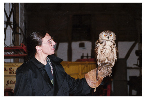 Ben Russell holds an eagle own in a falconry exhibit in Stratford-on-Avon.